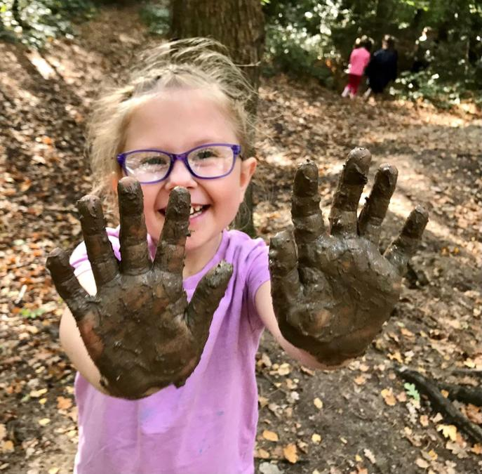 Big smiles and big muddy hands!