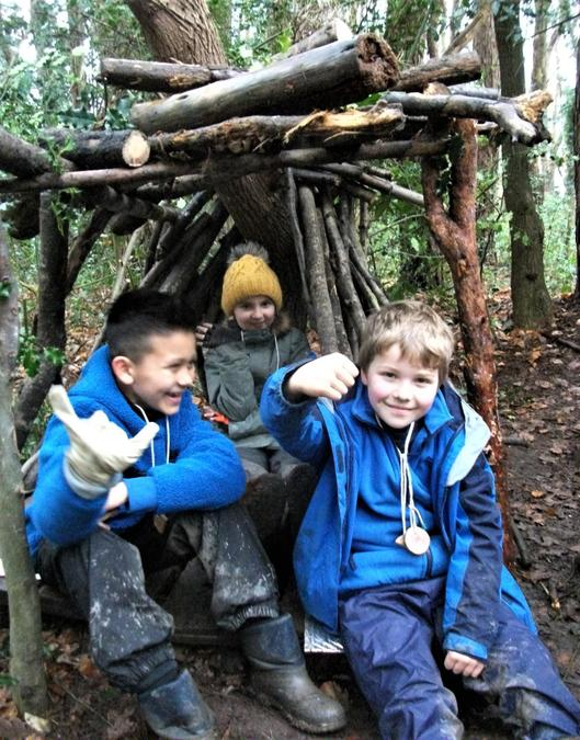 All smiles in the woodland shelter