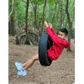 Ryan swinging in Copthorne Prep woods