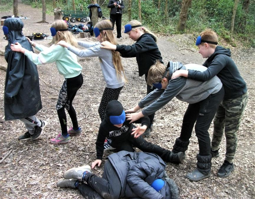 Blindfold games out in the woods
