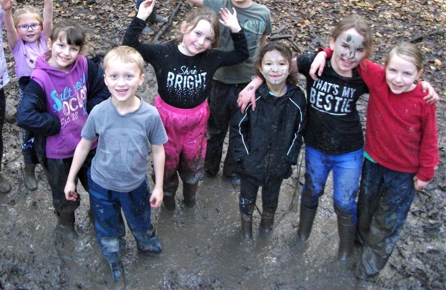 All smiles in the mud