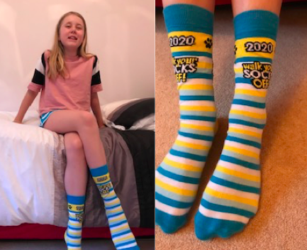 Izzy's funky socks she earnt for her charity challenge!