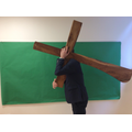 Mr Goodwin carrying the cross into the hall.