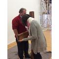 Mrs Froud touching the cross