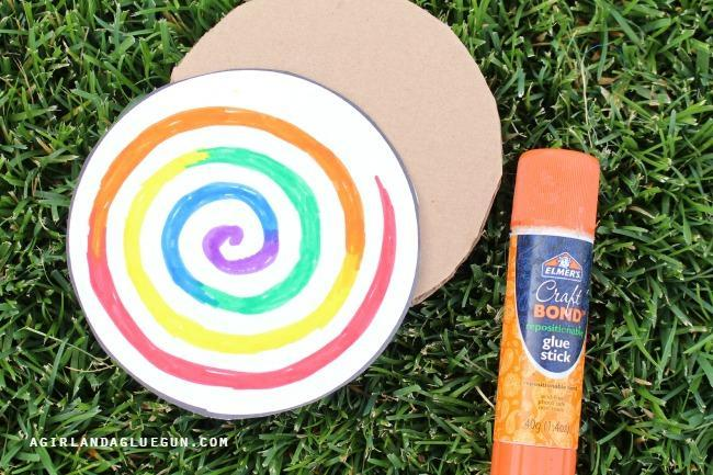 4. Glue paper circles onto each side of the card.