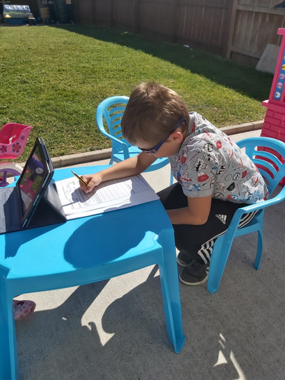 Thomas working hard on this spelling activities.