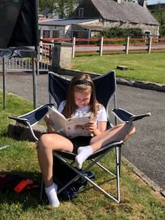 Relaxing in the sunshine with a good book!