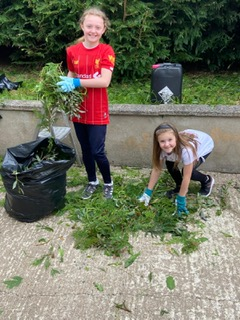 Lauren and Emily helping in the garden!
