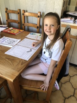 Emily is busy learning her spellings.