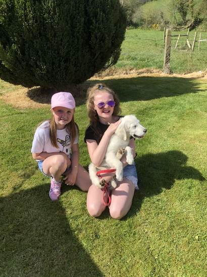 Emily and Lauren with their lovely pup!