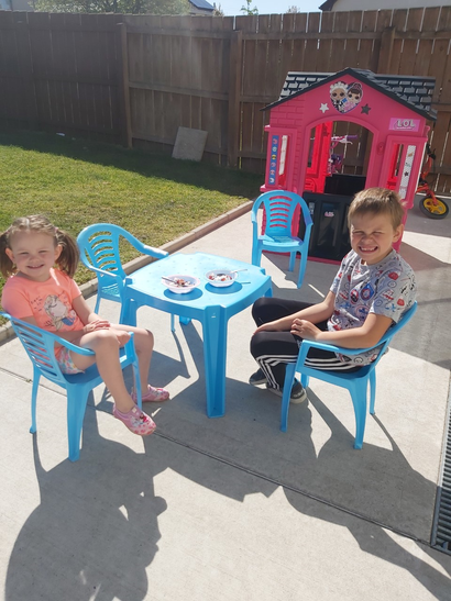 Thomas and Chloe having thier snack in the sun.