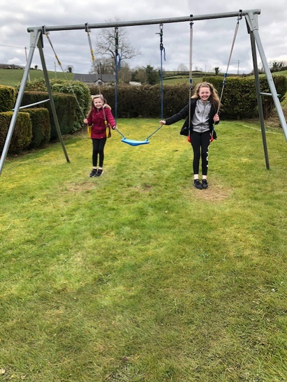 Emily and Lauren out having a swing!
