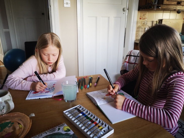 Sofia and Tilly using rainbow colours to draw!