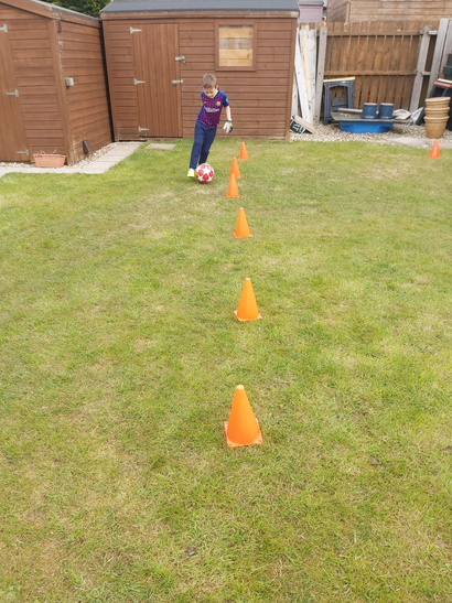 Thomas perfecting his dribbling skills!