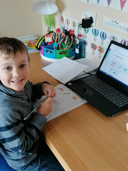 Sam looks very pleased with his work!