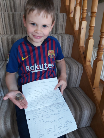 Thomas showing us his letter from the tooth fairy!