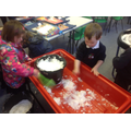 We had fun putting the snow into our water tray.