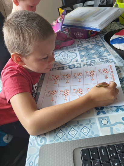 Thomas very busy on his maths