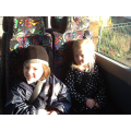 Cerys and Evie sat beside each other in the bus