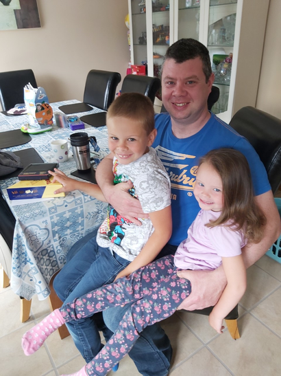 Thomas and Chloe giving their dad lovely presents.