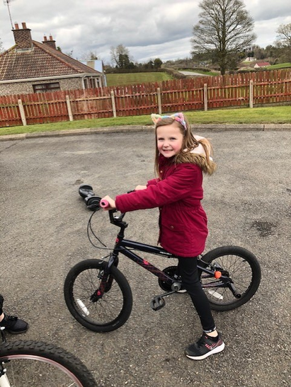 Emily taking a spin on her bike!
