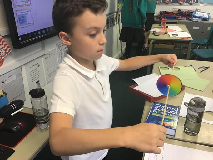 The children made colour wheels which, when spun, produced white light.