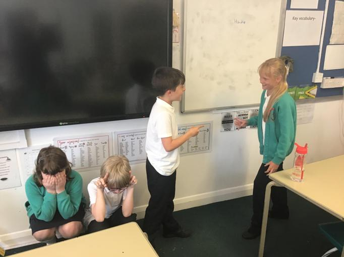 The children acted out a scene from the novel for the rest of the class to name it.
