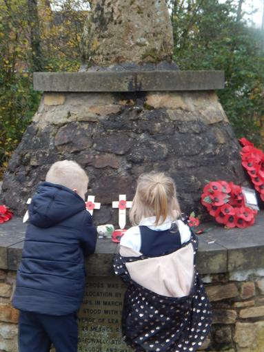We went on a Welly Walk to the cross to lay a poppy wreath