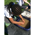 Washing the found artefacts.