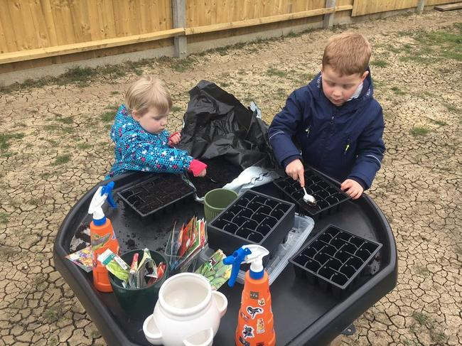 We had fun planting and writing the labels for each plant.