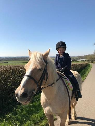 Riding my pony in the sunshine.