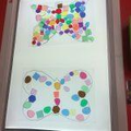 Can you design a butterfly on the lightbox? How can you make it symmetrical?