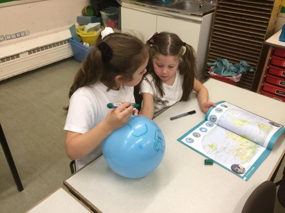 We made our own balloon globes.