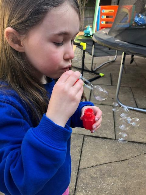 Blowing bubbles....blow your worries away...