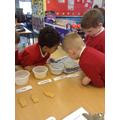 The boys are exploring liquids!
