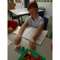 Using multilink and a ten frame to solve addition problems
