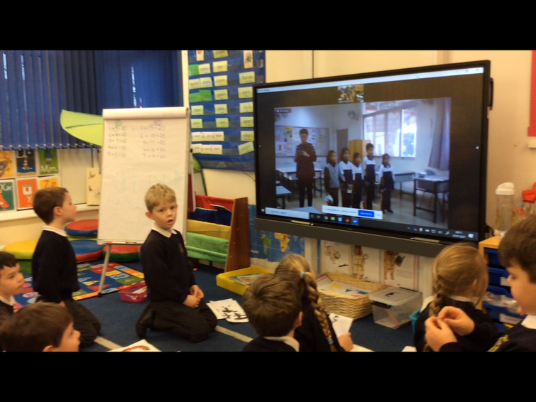 We listened to a song sung by a group of children.