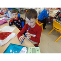 Conor plays away in a manger on the tin whistle.