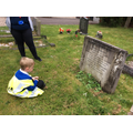 Reading information on the grave stones