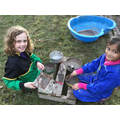 Making cement to cover the air raid shelter.