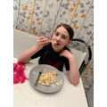 Using chopsticks to eat dinner.