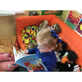 Our Book Corner has a comfy sofa for reading!