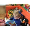 Our Book Corner has a comfy sofa for reading!