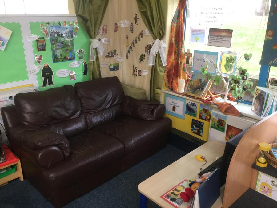 Read a book on our comfy sofa in our book corner.