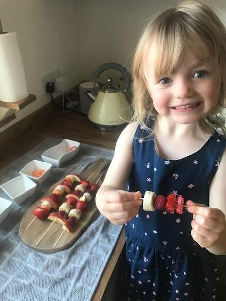 Evie made a fruit kebab for each of her family