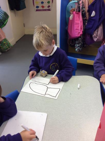 Drawing using white boards.
