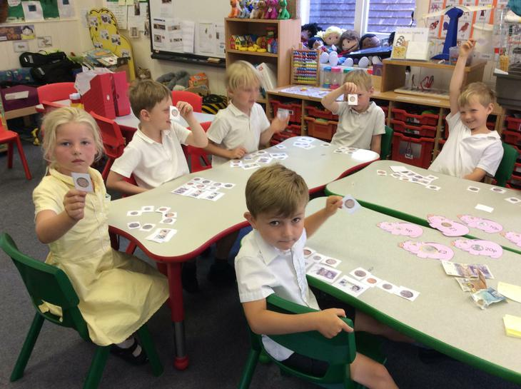 Learning about coins and notes in maths.