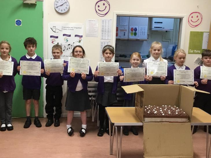 Celebrating our maths homework certificates!