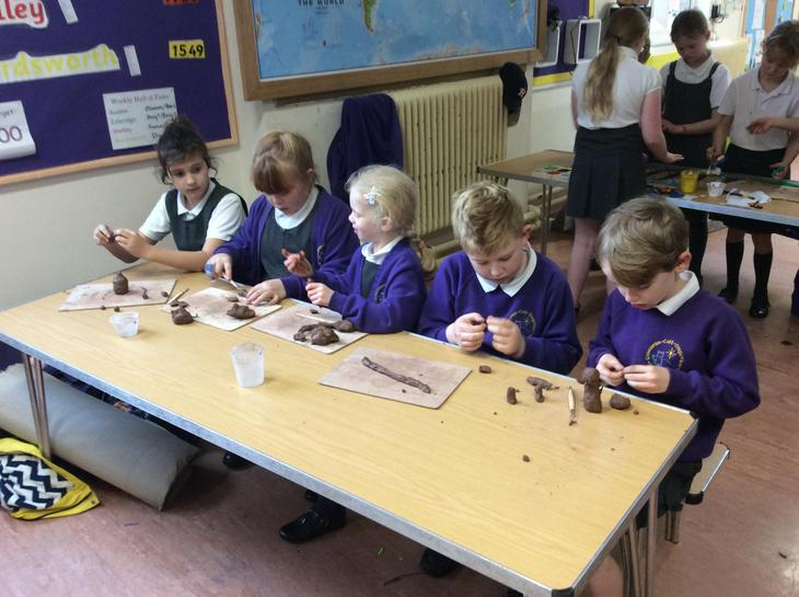 Making characters out of clay.