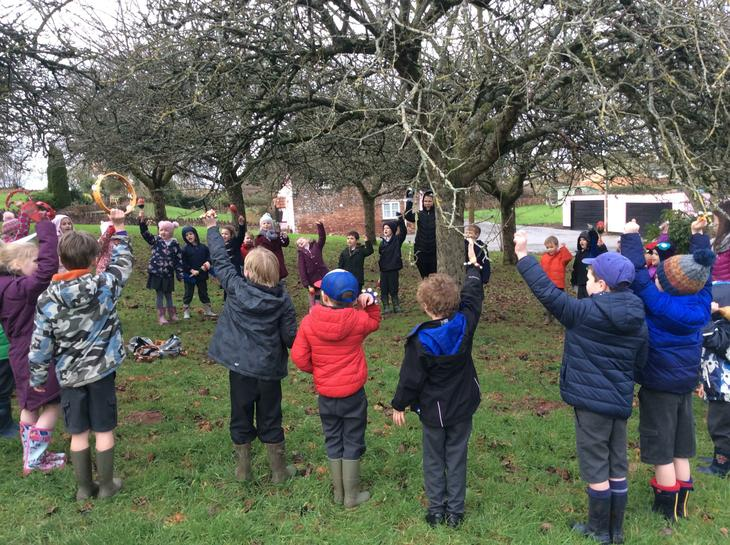 Wassailing the apple trees in the orchard.